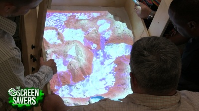 The AR Sandbox uses a projector and an Xbox Kinect to project topographical information onto a sandbox.